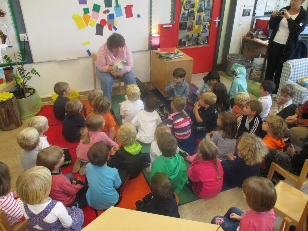 Miss Judith the Librarian reading to EY2
